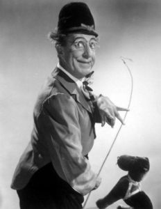 Ed Wynn as lion tamer