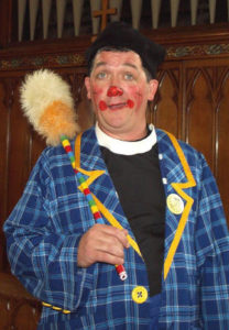 Roly Bain, clown minister