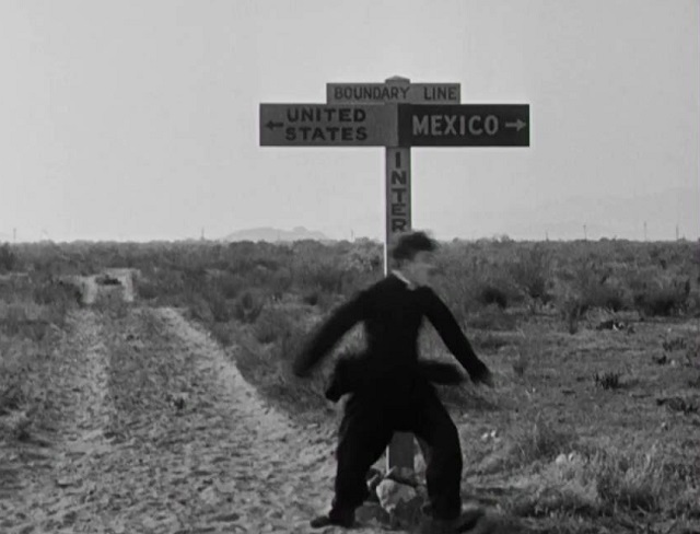 Charlie Chaplin straddles the border line at the end of The Pilgrim