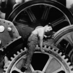 Charlie Chaplin riding the gears at the factory in Modern Times