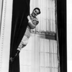 Charlie Chaplin as the Great Dictator, Adenoid Hynkel, sliding down the drapes