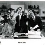 Harpo, Groucho and Chico develop the photograph that reveals the villain's identity in The Big Store