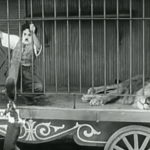 "The Circus - Charlie Chaplin trying to keep the ""friendly"" dog from waking the sleeping lion"