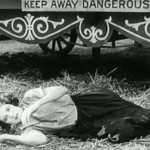 The Circus - Merna Kennedy recovers from her faint, to rescue Charlie Chaplin from the lion's cage