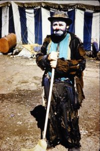 Color photo of Emmett Kelly with his famous broom, for his sweeping the spotlight routine