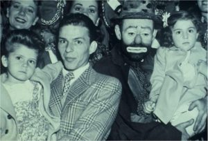 Frank Sinatra and Emmett Kelly at the circus (with their daughters)