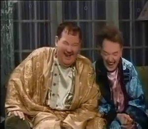 """I Wanna Dance! a colorized scene from Scram! where Oliver Hardy and Stan Laurel have gotten drunk on """"water"""""""