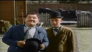 Oliver Hardy and Stan Laurel are reduced to begging in One Good Turn