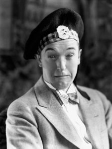 Photo of Stan Laurel in a kilt from Putting Pants on Philip