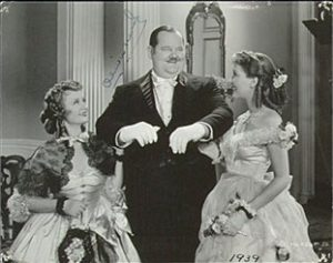 Wife (Billie Burke), Oliver Hardy, and their daughter