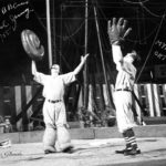 Paul Jung and Myron Orton in the ring, doing a baseball skit