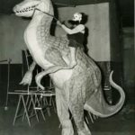 Paul Wenzel marching with a dinosaur