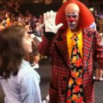 """Genna high-fives Toto at the Ringling Circus' """"Fully Charged"""" in Bettendorf, IA in 2012"""