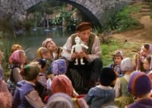 Danny Kaye as Hans Christian Andersen performs The Emperor's New Clothes for the children
