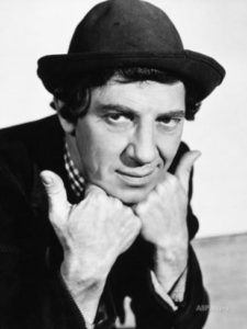 Chico Marx, face in hands