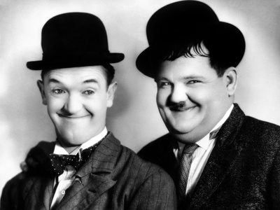 Stan Laurel and Oliver Hardy in their iconic bowlers