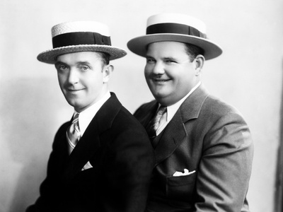 Stan Laurel and Oliver Hardy in an early Hal Roach Studio portrait shot - mid 1920's