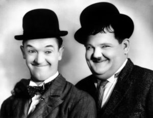Stan Laurel and Oliver Hardy in character