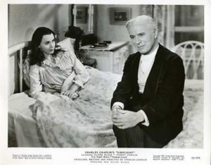Claire Bloom recovering in bed, talking with Charlie Chaplin, in Limelight