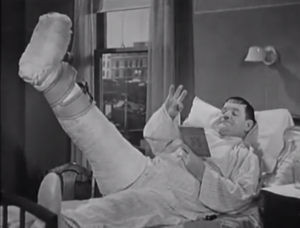 County Hospital - Oliver Hardy relaxing in hospital bed