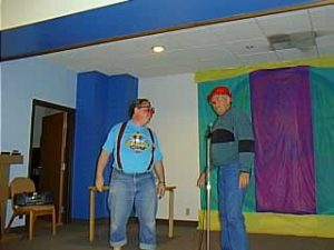 "The infamous, hilarious, Busy Bee skit as performed by Jim Howle (right), Dave Mitchell (left) and Lee Mullally (not pictured). The audience seats needed seat belts, to prevent us from falling out of them while laughing. This was on one of the Open Mike sessions, which was supposed to give the Clown Campers a chance to get up & perform -- the staff tended to ""fill in"" during the first day or two, while we got our courage up -- which, frankly was a good thing, as it gave us some excellent ideas from some of the best. p.s. the Busy Bee skit was created by Coco, and is included in several collections of skits, including World's Funniest Clown Skits"