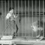 The Circus - now that the door's unlocked, Charlie Chaplin bravely approaches the lion -- until it roars!
