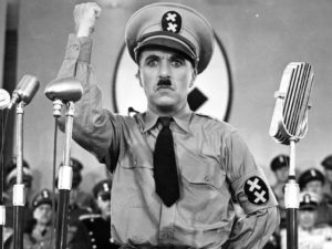 """The Great Dictator - Charlie ChaplinThe Great Dictator, starring Charlie Chaplin, Paulette Goddard, Jack Oakie, Reginald Gardiner, Henry Daniell, Billy Gilbert Buy from Amazon.com The Great Dictator, possibly the most well-known of Charlie Chaplin's films, was a timely satire on Nazisim and fascism in general, and Adolph Hitler in particular. In it, Charlie Chaplin plays a double role -- Adenoid Hynkel, autocratic dictator of Tomania who blames the Jewish people for all of society's ills, and a Jewish Barber who happens to be the spitting image of Hynkel.Contrary to what some people believe, the Jewish Barber was not Chaplin's world-famous tramp character, although they clearly share some of the same traits. The film is a true classic, with the famous """"dance with the globe"""" where Hynkel dances with an oversized inflated image of the globe, fantasizing about his eventual conquests. The film ends with the famous """"Look Up, Hannah"""" speech which is, perhaps, both verbose and even hokey, but it fits properly and plays well. I rate it 4 clowns on a 5-clown scale. Editorial review of The Great Dictator, starring Charlie Chaplin, Paulette Goddard, Jackie Oakie, Billy Gilbert, courtesy of Amazon.com movie poster for """"The Great Dictator"""" starring Charlie ChaplinSince Adolf Hitler had the audacity to borrow his mustache from the most famous celebrity in the world - Charlie Chaplin - it meant Hitler was fair game for Chaplin's comedy. (Strangely, the two men were born within four days of each other.) The Great Dictator, conceived in the late thirties but not released until 1940, when Hitler's war was raging across Europe, is the film that skewered the tyrant. Chaplin plays both Adenoid Hynkel, the power-mad ruler of Tomania, and a humble Jewish barber suffering under the dictator's rule. Paulette Goddard, Chaplin'€™s wife at the time, plays the barber's beloved; and the rotund comedian Jack Oakie turns in a weirdly accurate burlesque of Mussolini, as a bellowing fellow dictator """