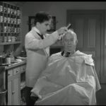 """Famous scene of the barber shop. Charlie Chaplin and Chester Conklin from """"The Great Dictator""""."""