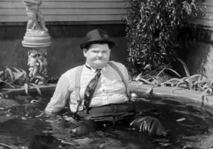 Hog Wild - colorized photo of Oliver Hardy in the fountain ... again