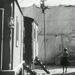 The Circus - after running away from the lion at breakneck speed, Charlie Chaplin climbs as far away as he can get