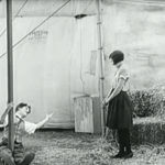 The Circus - after coming down, Charlie Chaplin impresses Merna Kennedy