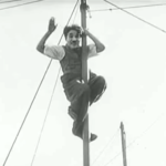 The Circus - from the top of the pole, Charlie Chaplin waves to Merna Kennedy before coming down