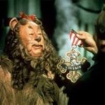 """Bert Lahr, in costume as the Cowardly Lion in the Wizard of Oz, being given his medal for """"Courage"""""""