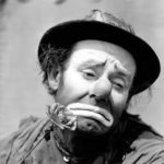 Emmett Kelly with a rose