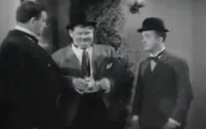 Hollywood Party - Oliver Hardy and Stan Laurel try to get in