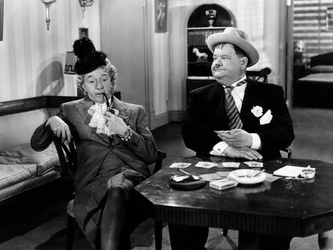 Stan Laurel in drag, along with southern gentleman Oliver Hardy, as part of the scheme to steal back the money