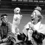 Lou Jacobs balancing his dog on his hand