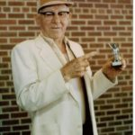 Lou Jacobs with statue