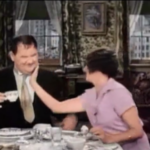 Their First Mistake - Oliver Hardy and Mae Busch happily at home
