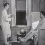 They Go Boom! Stan Laurel trying to 'help' Oliver Hardy with a foot bath