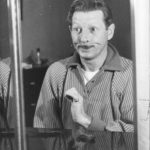 Danny Kaye making funny faces in the mirror