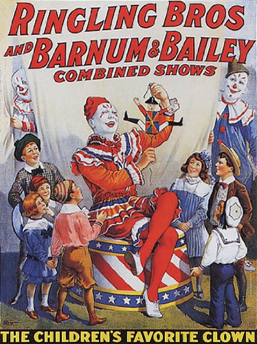 Pat Valdo, in whiteface clown makeup, entertaining a group of children with a toy