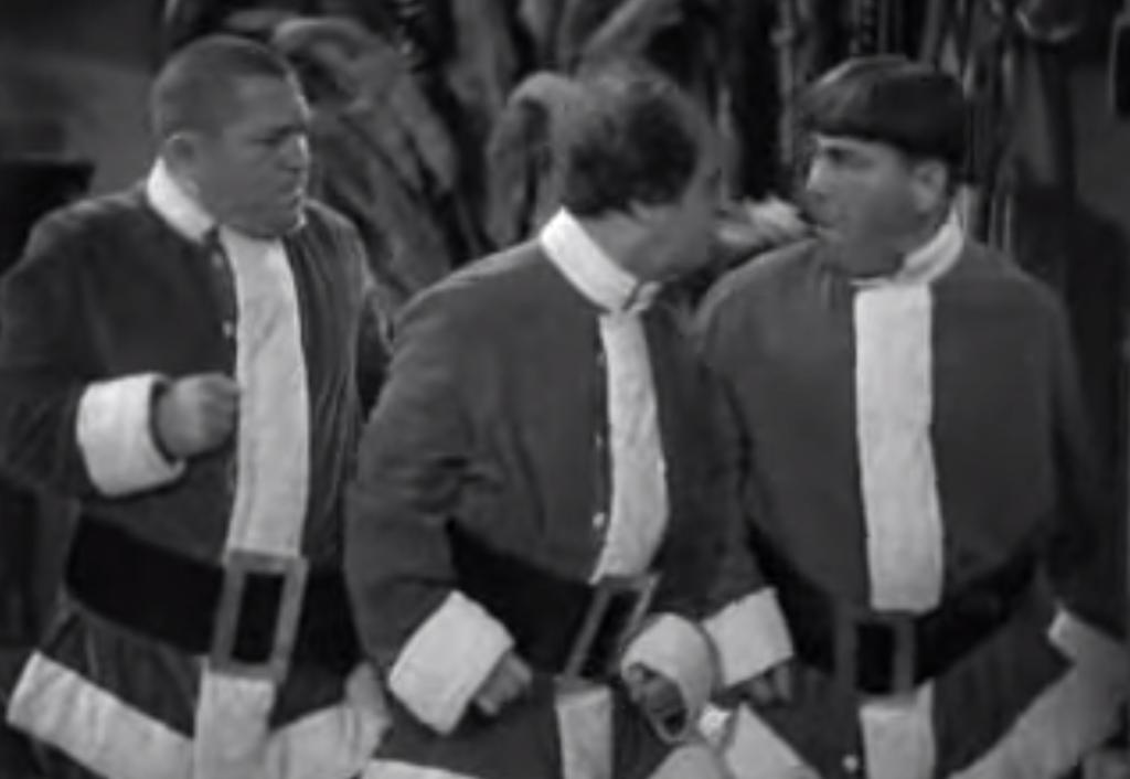 Curly, Larry, and Moe in Santa suits in Wee Wee Monsieur