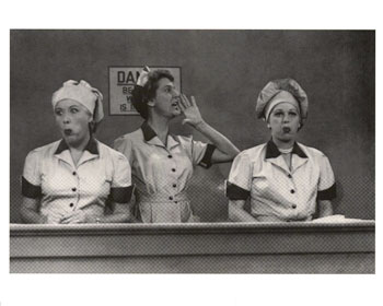 """An actual scene from the notorious """"Job Switching"""" episode of I Love Lucy. Note how Lucy and Ethel's cheeks are bulging from the chocolates that they've been stuffing in their mouths, since the candy's been coming on the conveyor belt faster than they can deal with. Also note the forewoman's shouting to her coworkers to """"speed it up a little!"""""""