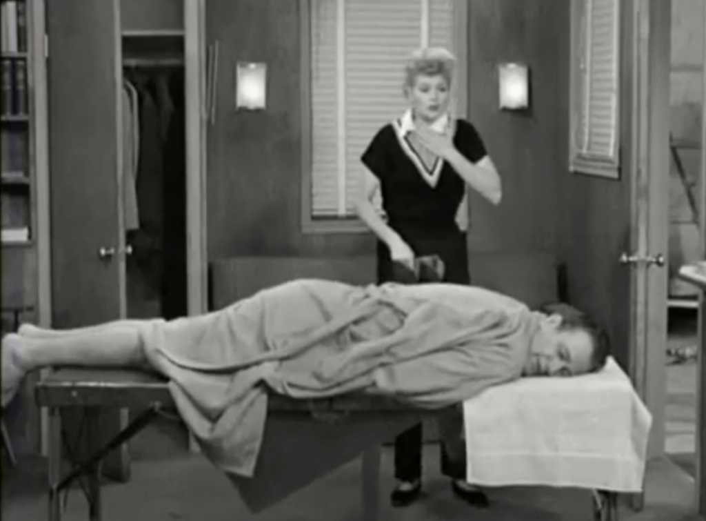 Lucy meets John Wayne - while trying to borrow John Wayne's boots, Lucy has to give him a massage