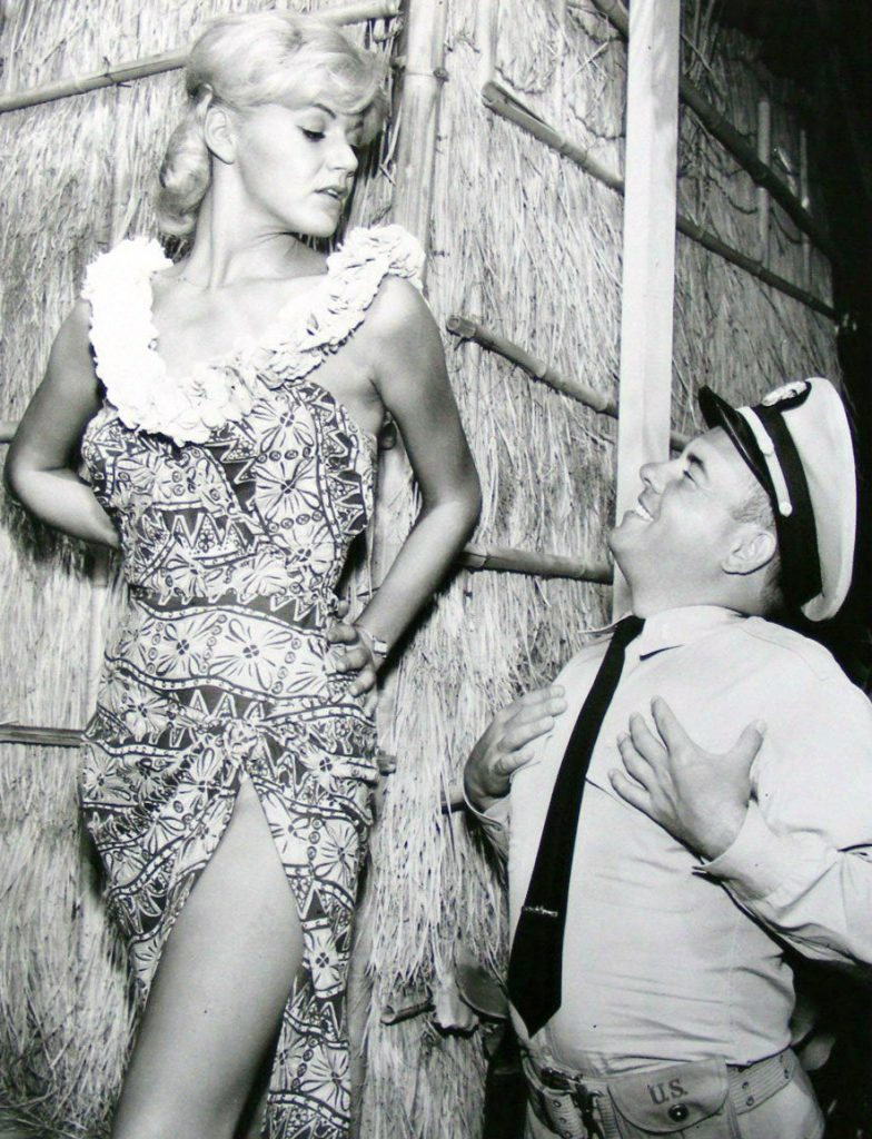 """McHale's Navy. Pictured are Rochelle Rac and Tim Conway as Ensign Parker at """"McHale's Paradise Hotel""""."""