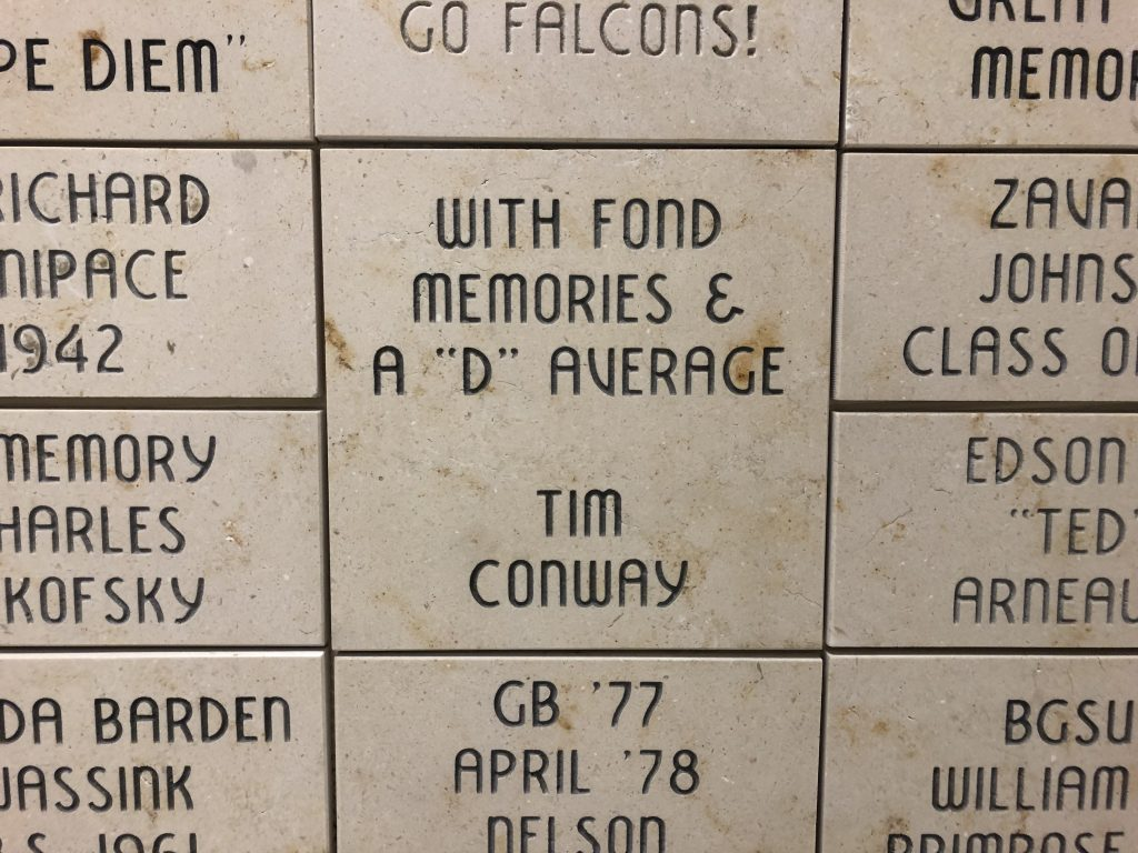 A brick sponsored by Tim Conway in a university building.
