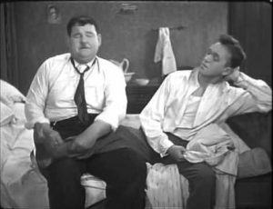 "Oliver Hardy accidentally rubbing Stan Laurel's foot in ""Angora Love"""
