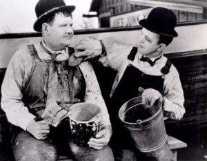 """Oliver Hardy and Stan Laurel painting their boat in """"Towed In a Hole"""""""