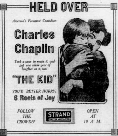 Movie poster of The Kid - Jackie Coogan and Charlie Chaplin hugging